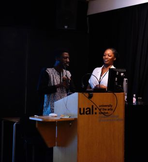 Mariama Wurie and another participant stand at the lectern