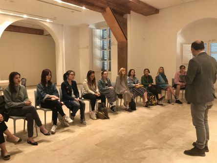 Students listening to talk being given as part of the project