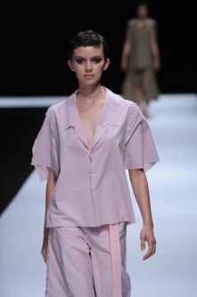 Female model wearing pastel purple suit designed by Enol Garcia Granda