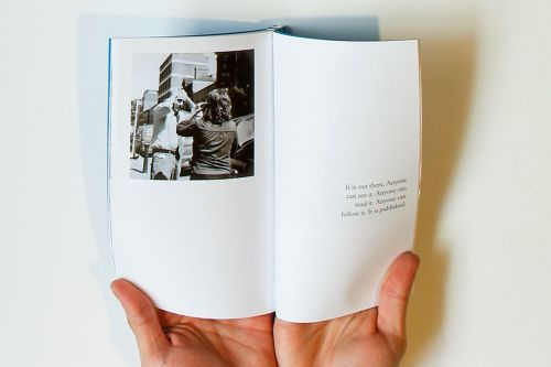 Student work called Acts of Publication featuring photography in a book