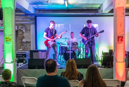 A band plays to entertain private view guests