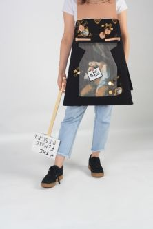 model wearing skirt which resembles a black billboard