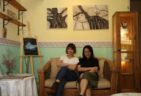 Artist with friend on sofa