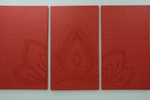a triptych of red painings