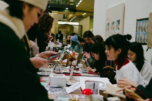 Holiday Market vendors and buyers in The Street CSM