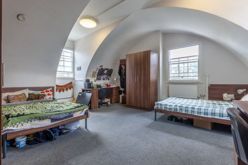 Large Twin Bedroom with 2 separate 3/4 beds, individual large wardrobes, individual desks, bright window and lots of floor space
