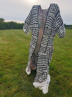 Black and white jacket photographed in a field