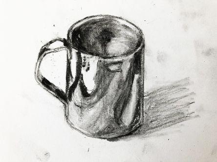 Charcoal drawing of a mug.