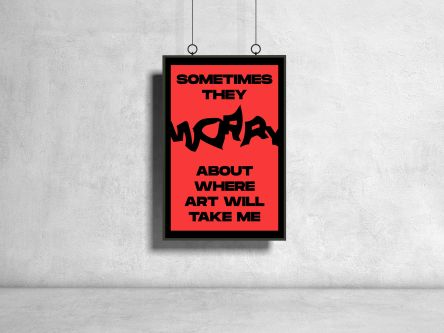 "Red and black poster hanging in front of gray concrete wall says ""Sometimes they worry about where art will take me""."