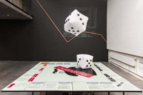 Work showing a large-scale version of a Monopoly board - renamed Oligarchy - as part of the exhibition Capital City at LCC.