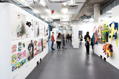 students looking around the Foundation Fashion and Textiles Exhibition