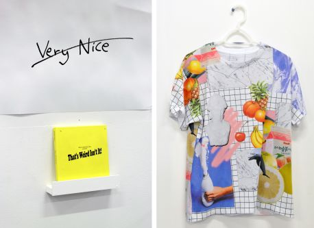 paper with 'very nice' written and crossed out, next to a shirt with fruit printed on