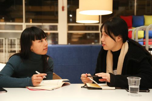 Photograph of two women in conversation at an Industry Mentoring Scheme event at London College of Communication.