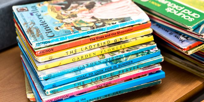 a pile of old lady bird books, they look well used, like they've been loved over the years