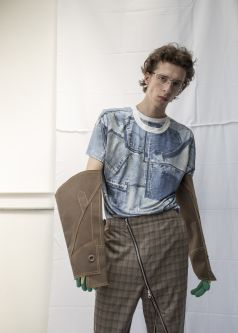Man in tween zipped trousers