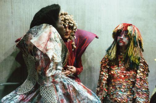 Three models wearing a range of detailed garments