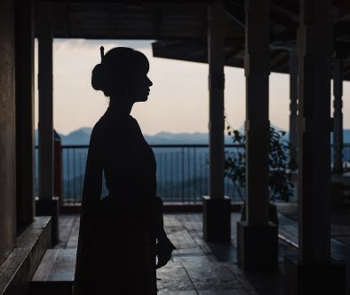 Photograph of silhouetted female model wearing a kimono