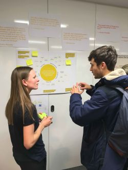 Student discussing Rough Sleeping in Camden project with visitor