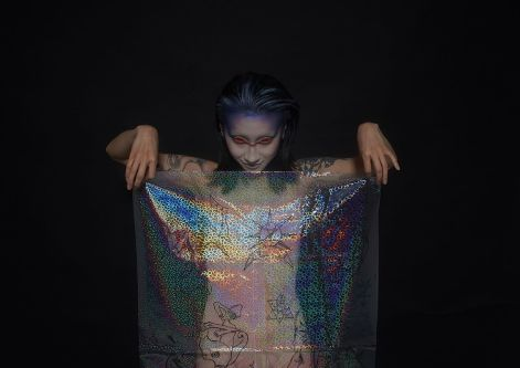 Model holding holographic fabric