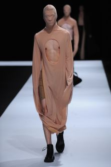 Male model with flesh coloured clothing covering face