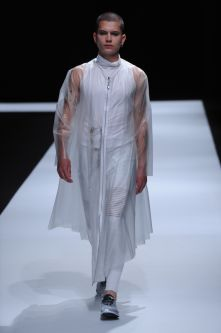 Male model in white clothing with clear perspex coat
