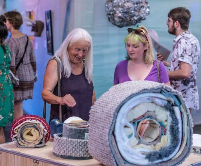 Visitors look at artwork