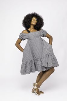Model wearing white and black patterned puffy dress