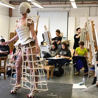 Model in a drawing class, wearing a bustle skeleton