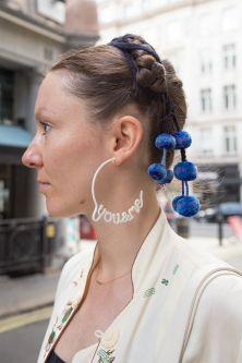 Zoe wearing You&Me earrings