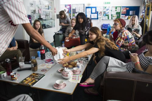 Lots of students enjoying afternoon tea in the common room together