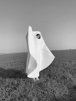 Woman wearing voluminous white garment