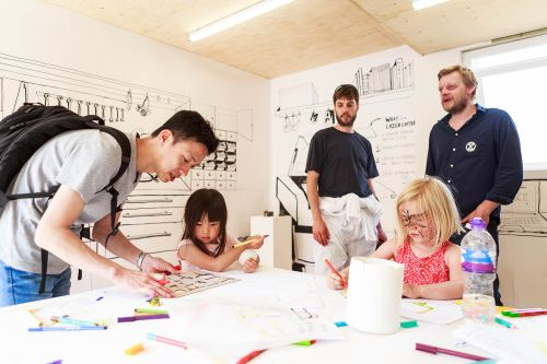 Adults and children working together on a project