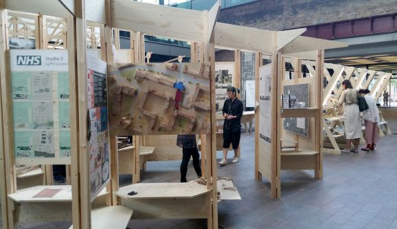 Installation of work displayed on a wooden structure.