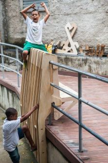 Children playing on wooden structures