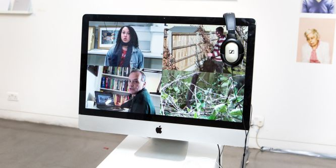 Close up of an Apple iMac with a video on the screen