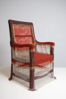 A chair covered in a woven textile
