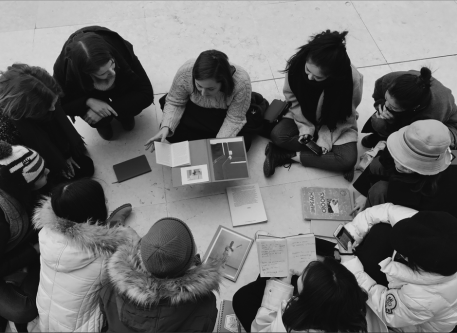 group of people sitting on the floor in a circle