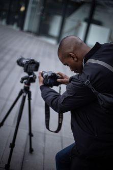 Man crouching taking pictures