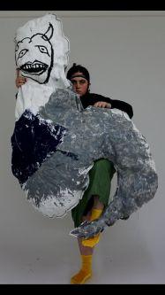 Woman holding large textile sculpture