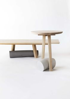 A wooden bench and coffee table, both have grey marble features