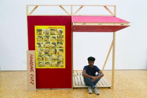 A person sat inside an installation