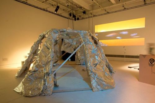 Photograph of a sculpture made of a wooden frame and covered in tin foil