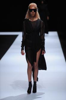 White model wearing asymmetric black dress designed by Jessica Whipp