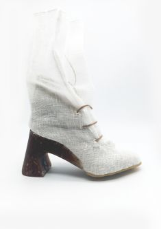 Heeled boot made of torn mesh material