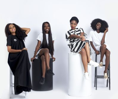 Bolupe's models wearing her designs, 4 of them sitting and posing