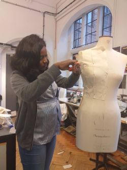 Tope working on her bodice