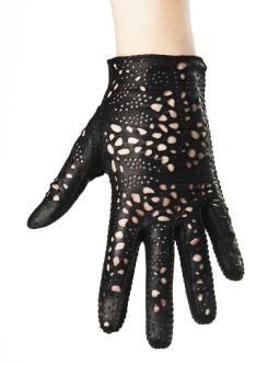 Black leather glove being worn, made by Riina Õun.