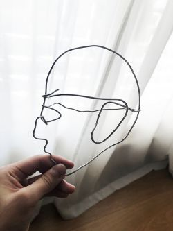 Wire sculpture shaped into a face.