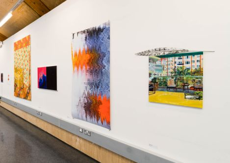 four canvases differing in size, mounted on a white wall