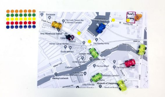 Black and white map of Camden, plotted with coloured dots and plastic cars.